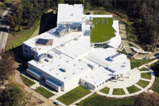 "aerial photograph of a building with a white or ""cool"" roof"